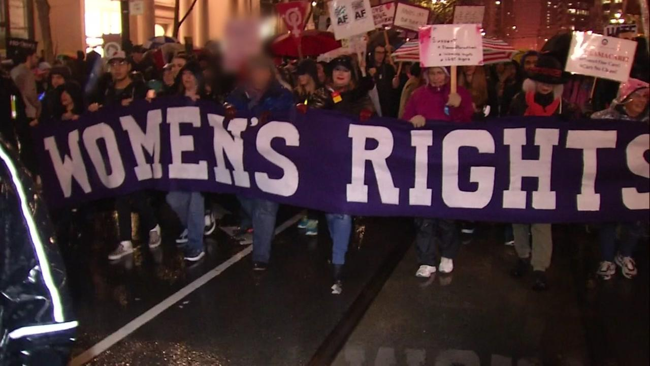A banner appears during the womens march in San Francisco in 2017.
