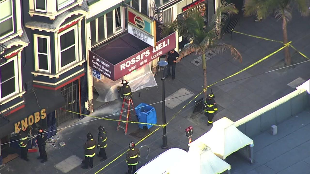 A deli in San Francisco is seen on Saturday, Jan. 20 after a vehicle drove onto the sidewalk and crashed into the building.
