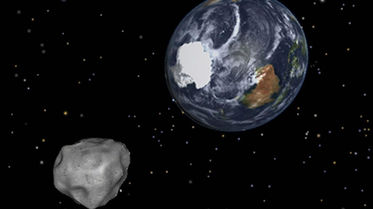 This image provided by NASA/JPL-Caltech shows a simulation of an asteroid approaching from the south as it passes through the Earth-moon system on Friday, Feb. 15, 2013.