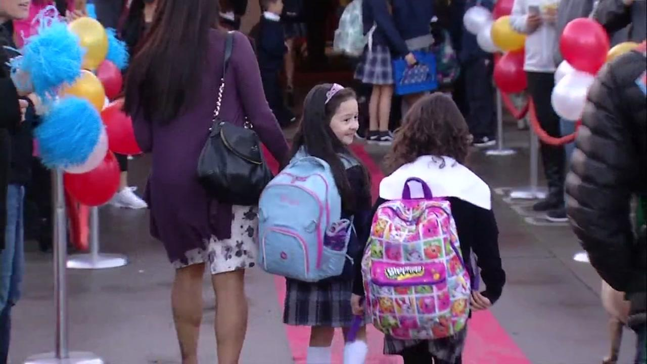 Students at St. Rose Catholic School in Santa Rosa, Calif. return to school on Monday, Jan. 22, 2018.