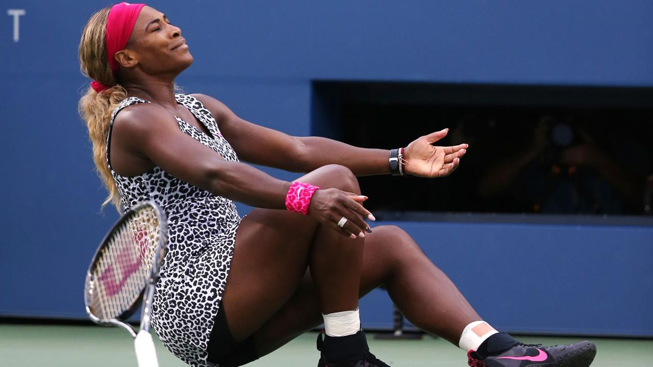 Serena Williams, reacts after defeating Caroline Wozniacki, of Denmark, during the championship match of the 2014 U.S. Open tennis tournament, Sunday, Sept. 7, 2014, in New York. (AP Photo/Mike Groll)