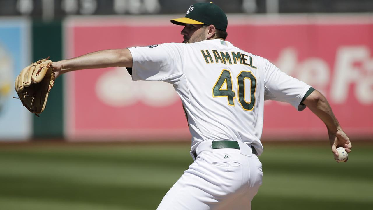 Oakland Athletics starting pitcher Jason Hammel throws to the Houston Astros during the first inning of a baseball game on Sunday, Sept. 7, 2014, in Oakland, Calif. (AP Photo/Marcio Jose Sanchez)