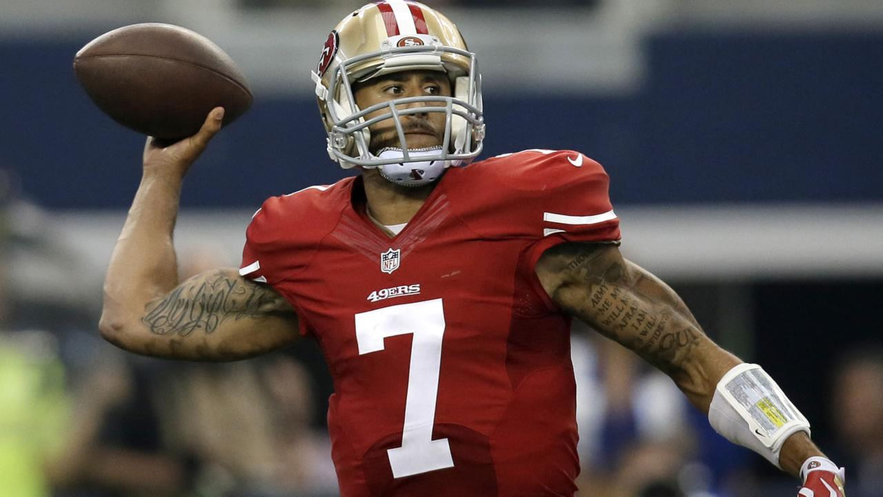 49ers Colin Kaepernick (7) passes against the Dallas Cowboys during the second half of an NFL football game, Sunday, Sept. 7, 2014, in Arlington, Texas. (AP Photo/Tony Gutierrez)