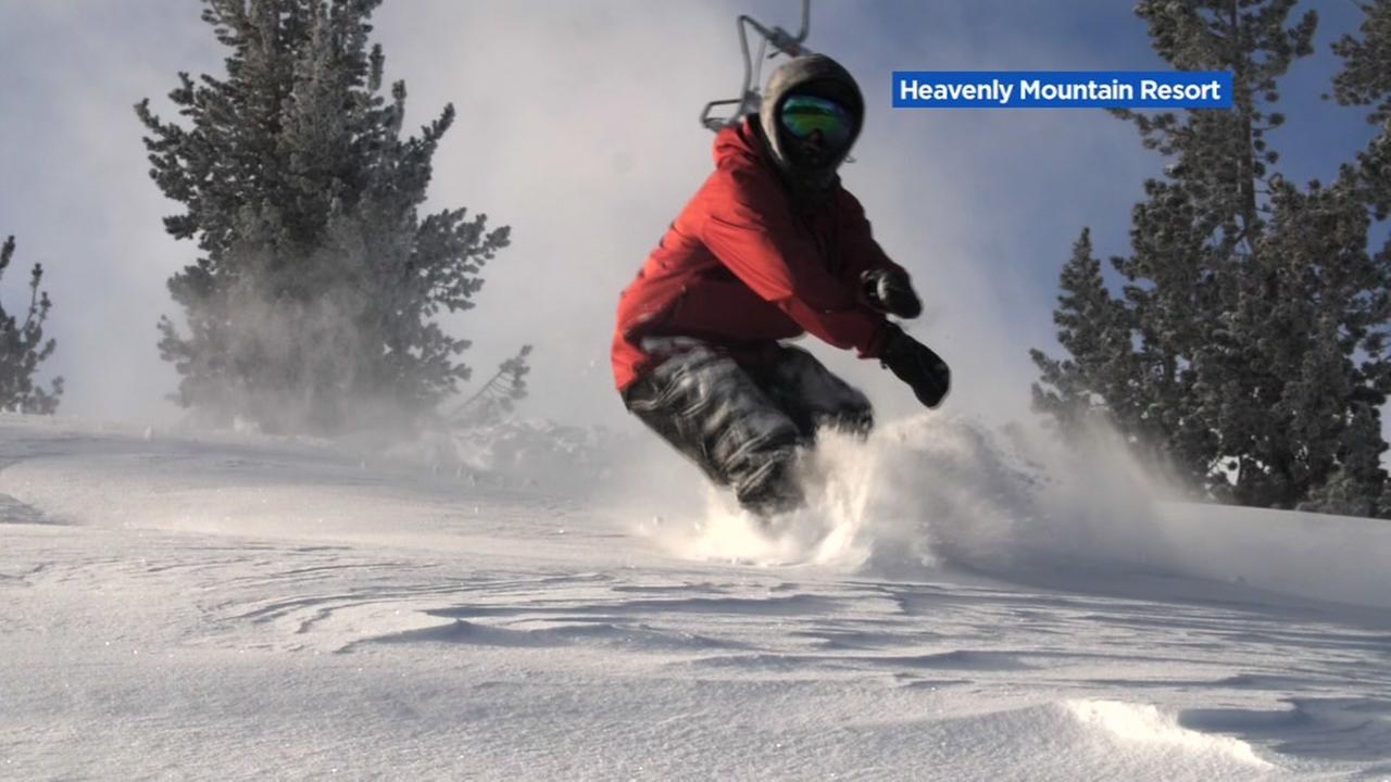 A snowboarder carves through fresh powder at Heavenly Mountain Resort.