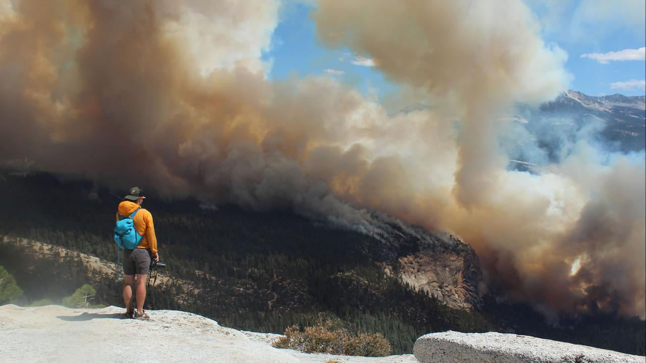 This Sunday, Sept. 7, 2014 photo provided by Rachel Kirk shows smoke from a fire rising above Little Yosemite Valley near Yosemite National Park, Calif.