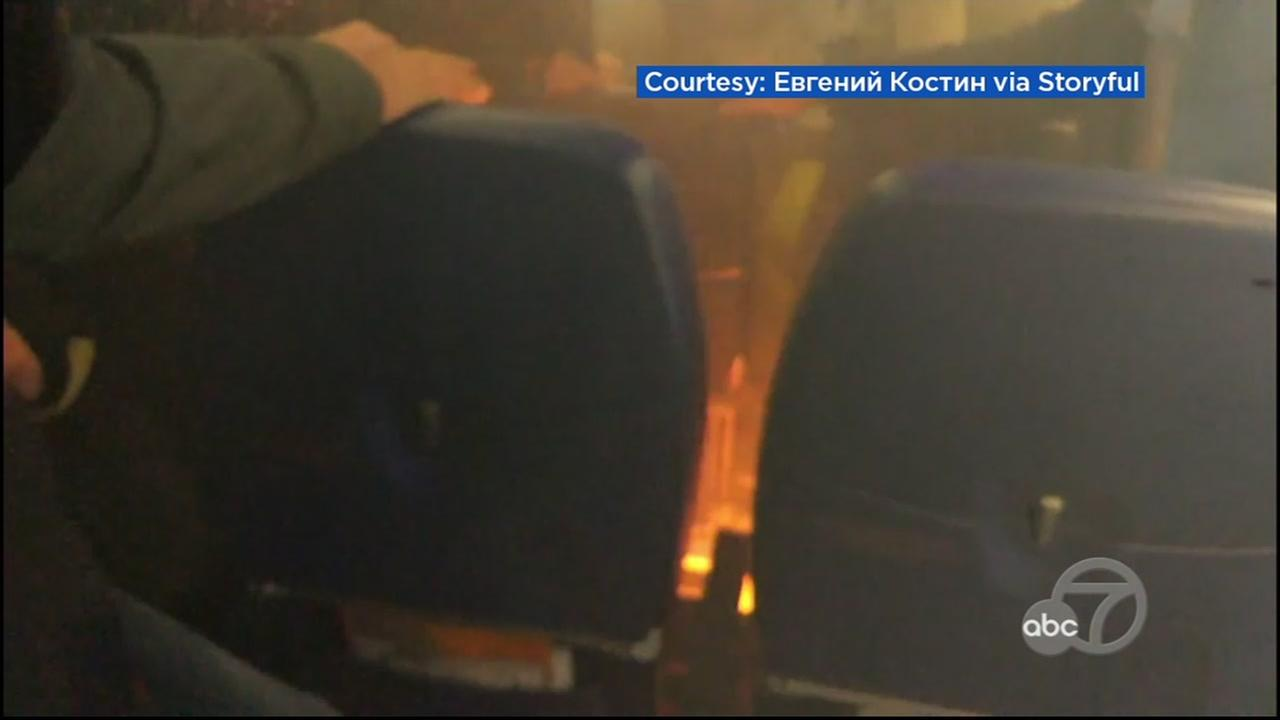 Video shows a fire caused by a charger on a Russian passenger jet on Wednesday, Jan. 31, 2018.