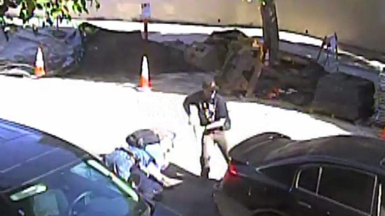 Surveillance video released Friday, Feb. 2, 2018 shows officers draw their weapons as the driver runs over his accomplice and a cop in San Francisco.