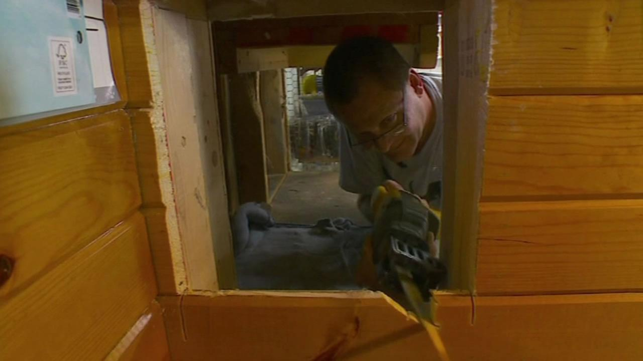 Greg Krueger adds on to the funhouse he built for his cats.