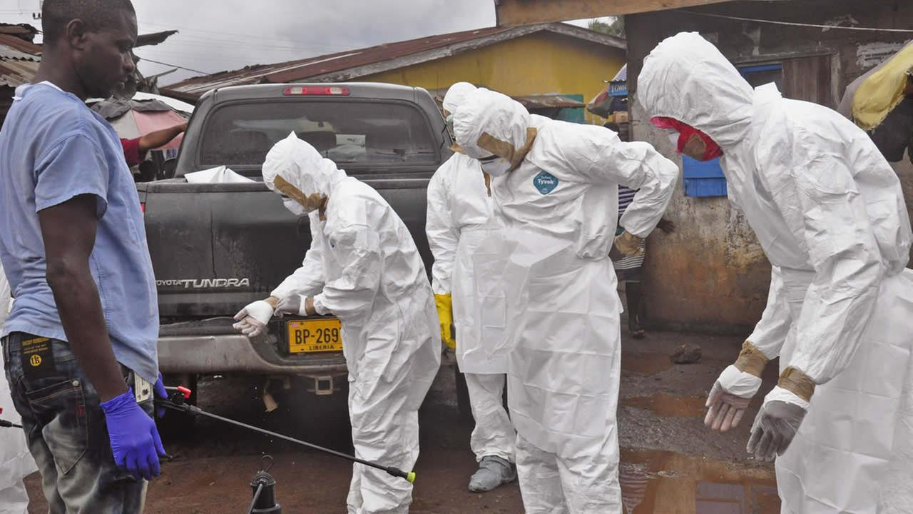 Health workers remove their protective clothes