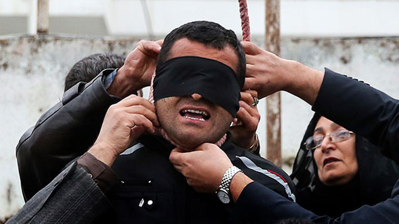 Incredible photos show a convicted killer about to be hung at the gallows in Iran just before he is spared - by the victims family.