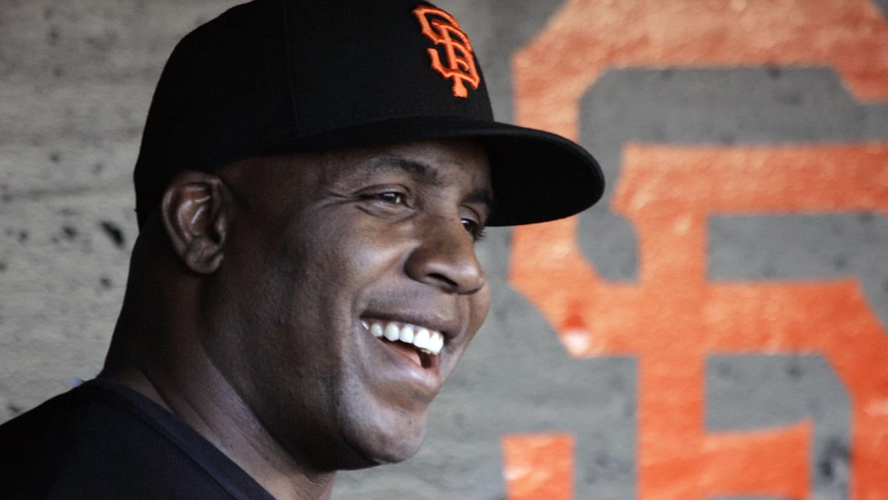 San Francisco Giants Barry Bonds laughs in the dugout after taking batting practice before their baseball game against the San Diego Padres in San Francisco, in this Sept. 25, 2007 file photo. (AP Photo/Eric Risberg, File)