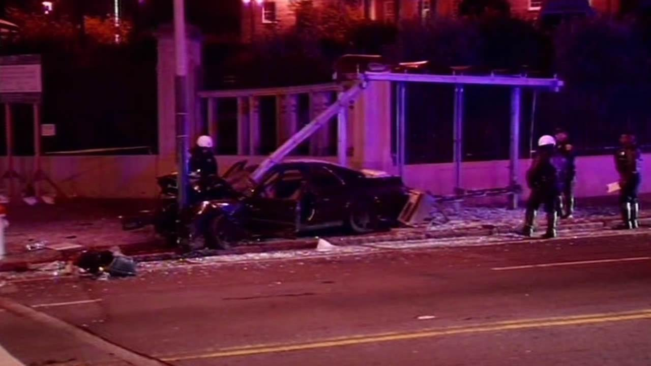 Car crashed into Muni bus stop and smashed all the glass