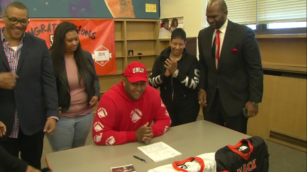 Amani Trigg-Wright signs with UNLV on Wednesday, Feb. 7, 2018 in Oakland, Calif.