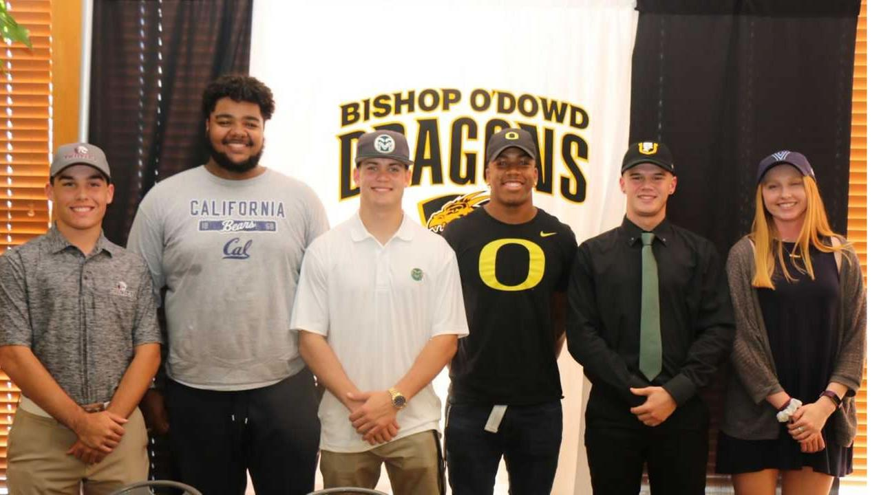 From L to R: Spencer Leader, Miles Owens, Quinn Brinnon, Jevon Holland, Harrison Kepp, and Madison Burke celebrate Signing Day at Bishop ODowd High School in Oakland, Calif.