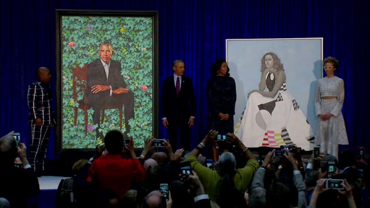 The Obamas celebrate their portrait unveiling in Washington DC, on Monday, Feb. 12, 2018.