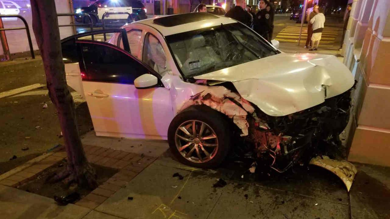 A damaged vehicle is seen in San Francisco after crashing into a building on Monday, Feb. 12, 2018.