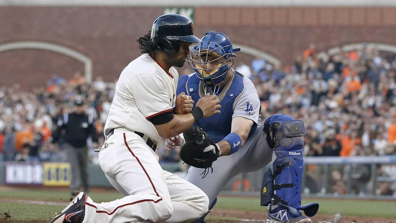 Los Angeles Dodgers catcher A.J. Ellis tags out San Francisco Giants Angel Pagan at home plate during the first inning of a baseball game Saturday in San Francisco.