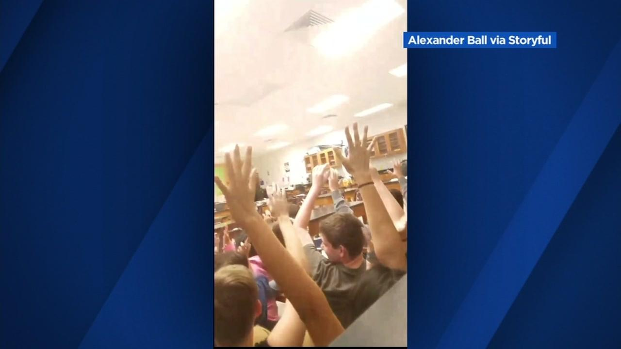 Students put their hands up as a SWAT team evacuates a classroom during a school shooting in Florida on Wednesday, Feb. 14, 2018.