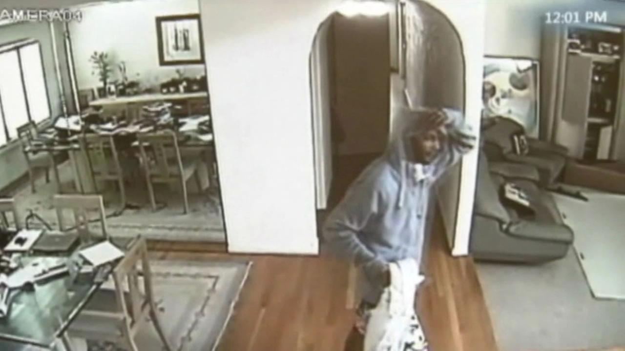 Surveillance footage from a Bel Air home shows a man allegedly burglarizing a a home.