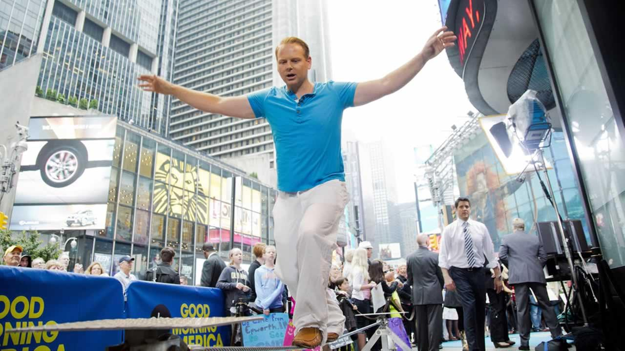 Daredevil Nik Wallenda practices walking a tightrope on ABCs Good Morning America in Times Square on Wednesday, June 13, 2012 in New York. (Photo by Charles Sykes/Invision/AP)