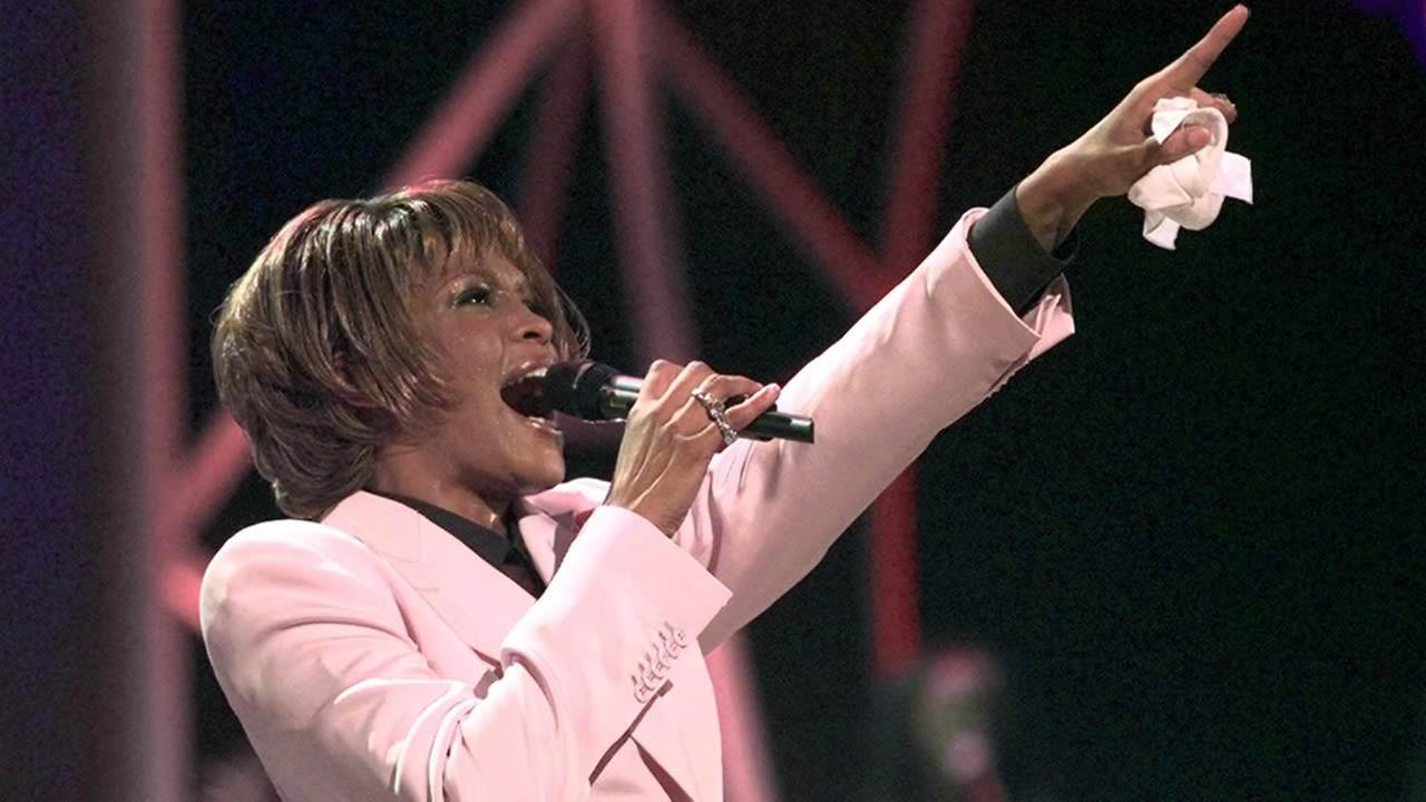 In this July 11, 1999, file photo, singer Whitney Houston performs Until You Come Back To Me during the 26th annual American Music Awards in Los Angeles. (AP Photo/Kevork Djansezian, File)
