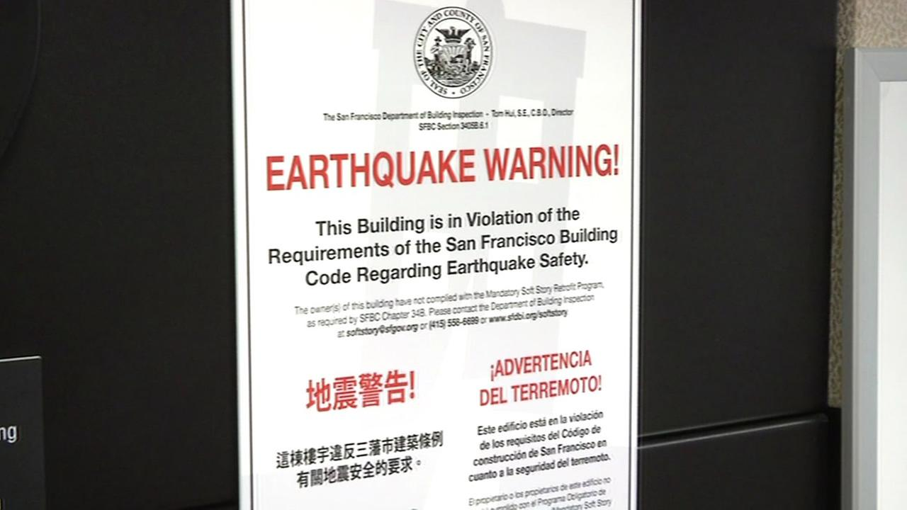 San Francisco officials plan to slap large signs on hundreds of apartment buildings to publicly shame their owners into complying with an earthquake safety ordinance passed last year.