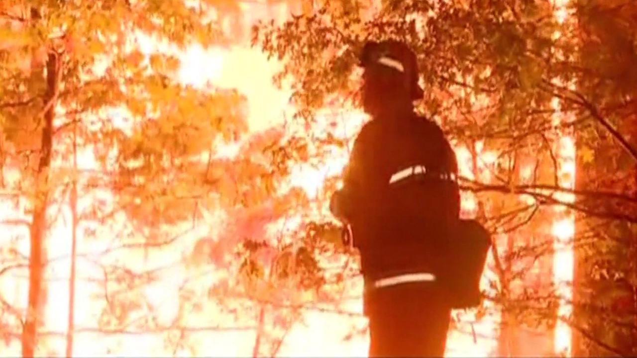 Fire burns near Hwy 50 in Lake Tahoe.