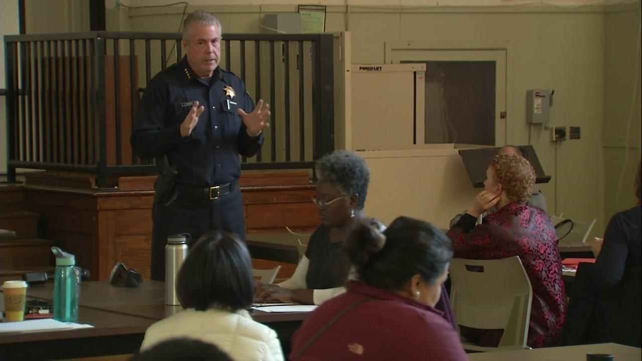 A police officer educates teachers on safety at the Oakland Unified School District in Oakland, Calif. on Thursday, Feb. 22, 2018.