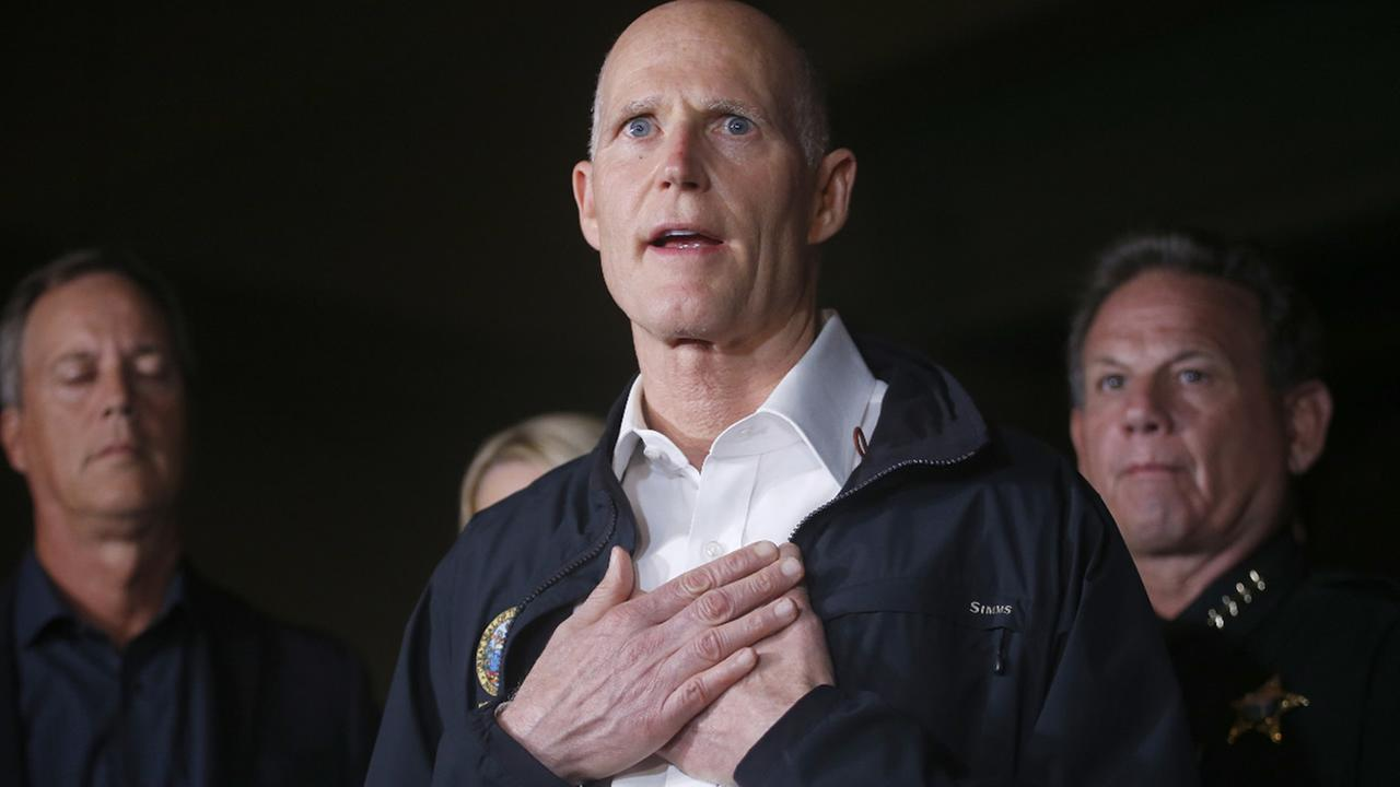Florida Gov. Rick Scott gestures as he speaks during a news conference near Marjory Stoneman Douglas High School in Parkland, Fla. Wednesday, Feb. 14, 2018. (AP Photo/Wilfredo Lee)