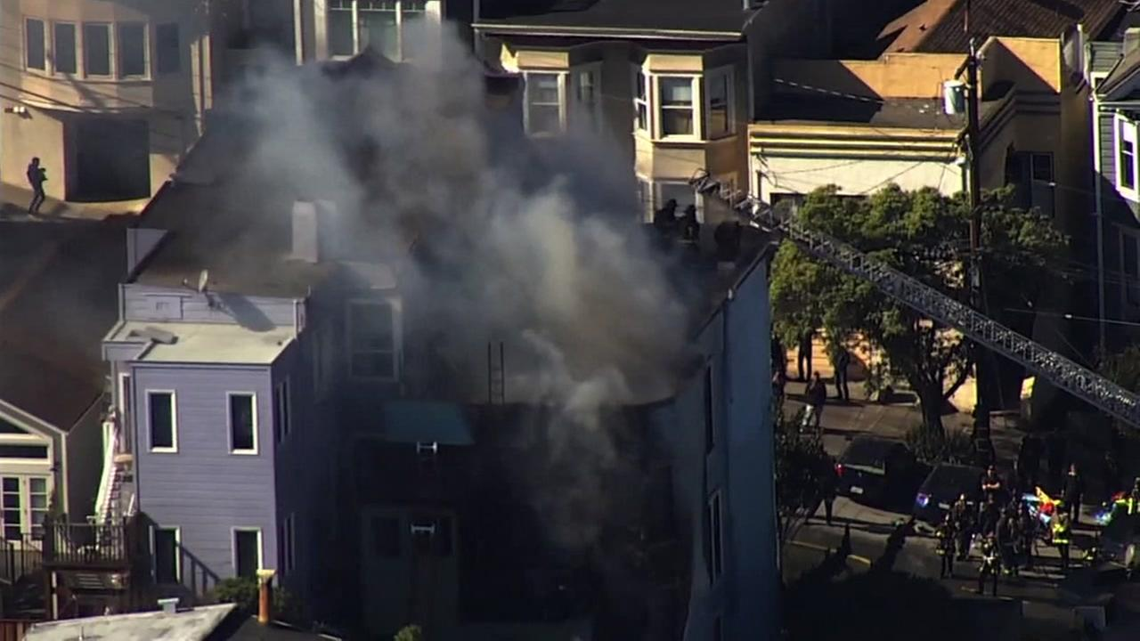Smoke rises from a building in San Franciscos Mission District on Friday, Feb. 23, 2018.