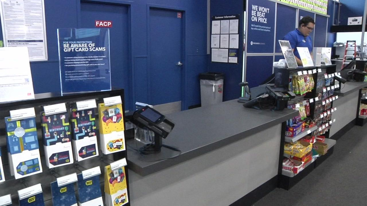 Best Buy has these signs warning about gift card scams at their store in San Carlos, Calif.