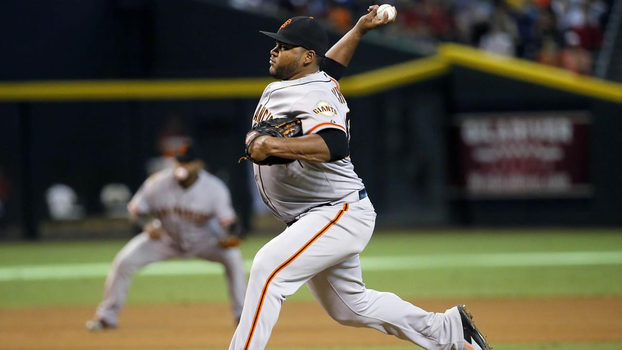San Francisco Giants pitcher Jean Machi throws against the Arizona Diamondbacks during the seventh inning of a baseball game, Sept. 17, 2014, in Phoenix. (AP Photo/Matt York)