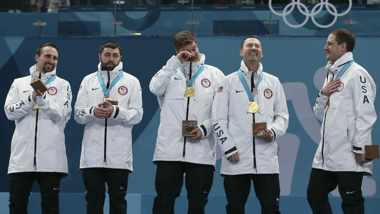 U.S. curlers Joe Polo, John Landsteiner, Matt Hamilton, Tyler George, John Shuster and Phill Drobnick are seen at the 2018 Winter Olympics in South Korea, Saturday, Feb. 24, 2018.