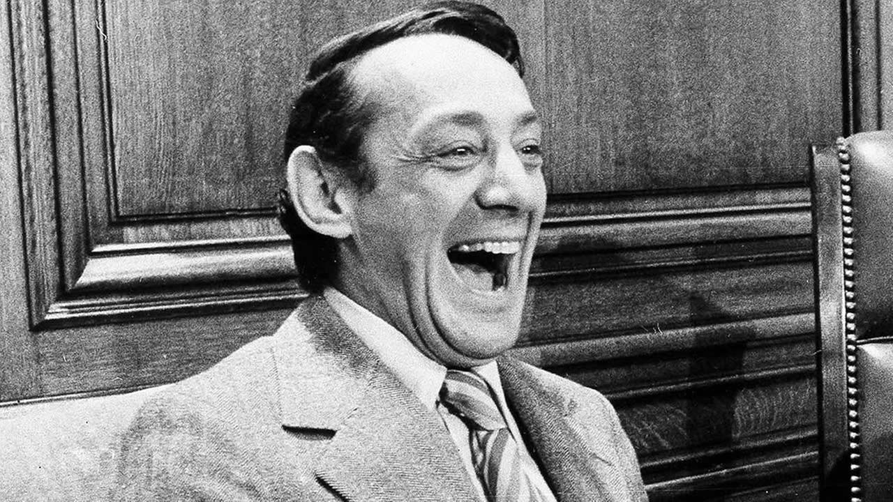In this April 1977 file photo, San Francisco supervisor Harvey Milk sits in the mayors office during the signing of the citys gay rights bill in San Francisco.