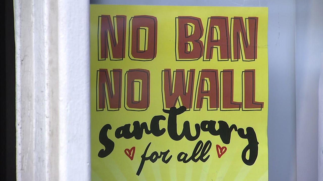 A poster of support appears in San Francisco on Thursday, March. 1, 2018. in response to ICE arrests in Northern California.