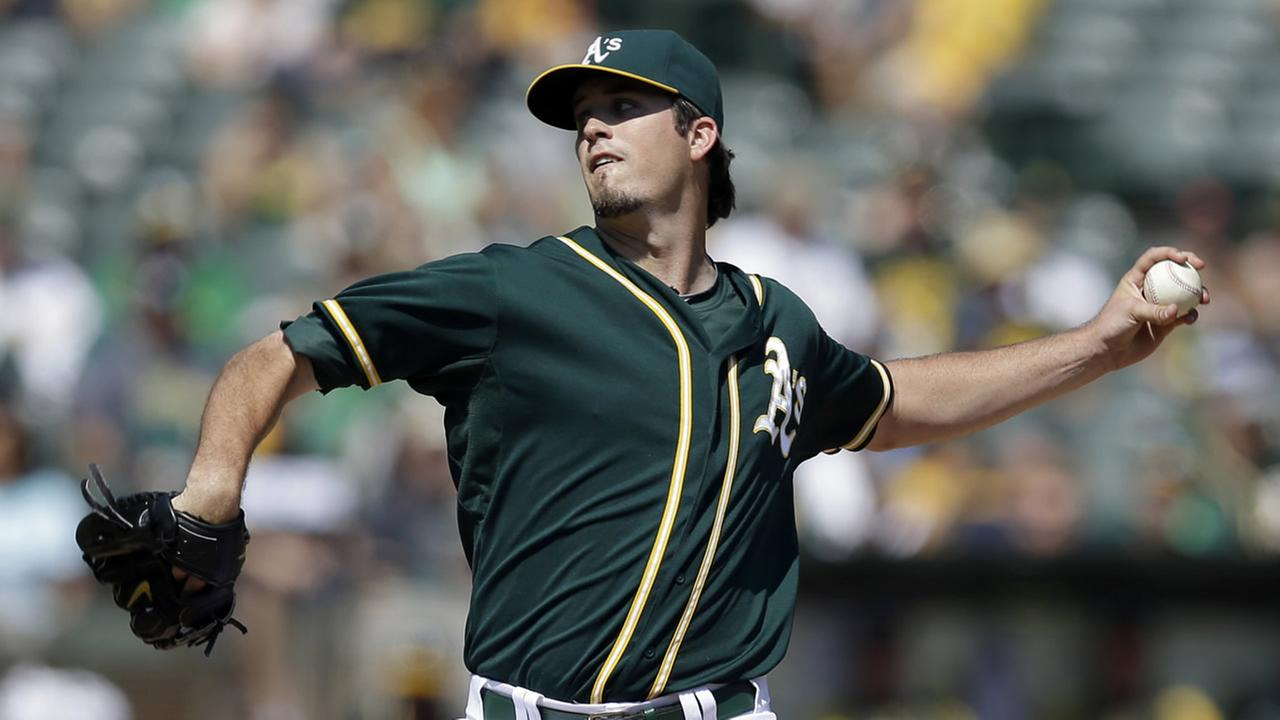 Oakland Athletics Drew Pomeranz delivers against the Philadelphia Phillies in the first inning of a baseball game Saturday, Sept. 20, 2014, in Oakland, Calif. (AP Photo/Ben Margot)