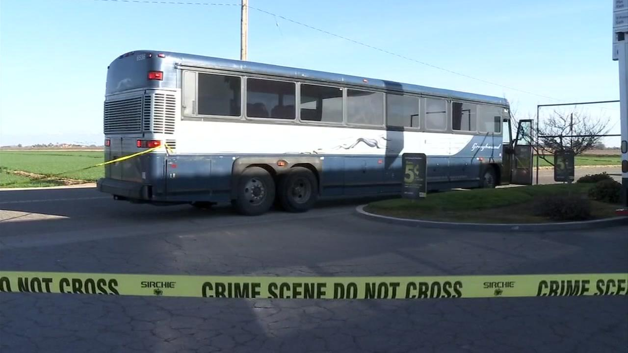 A stopped bus appears in Visalia, Calif. after officials say a stabbing occurred.