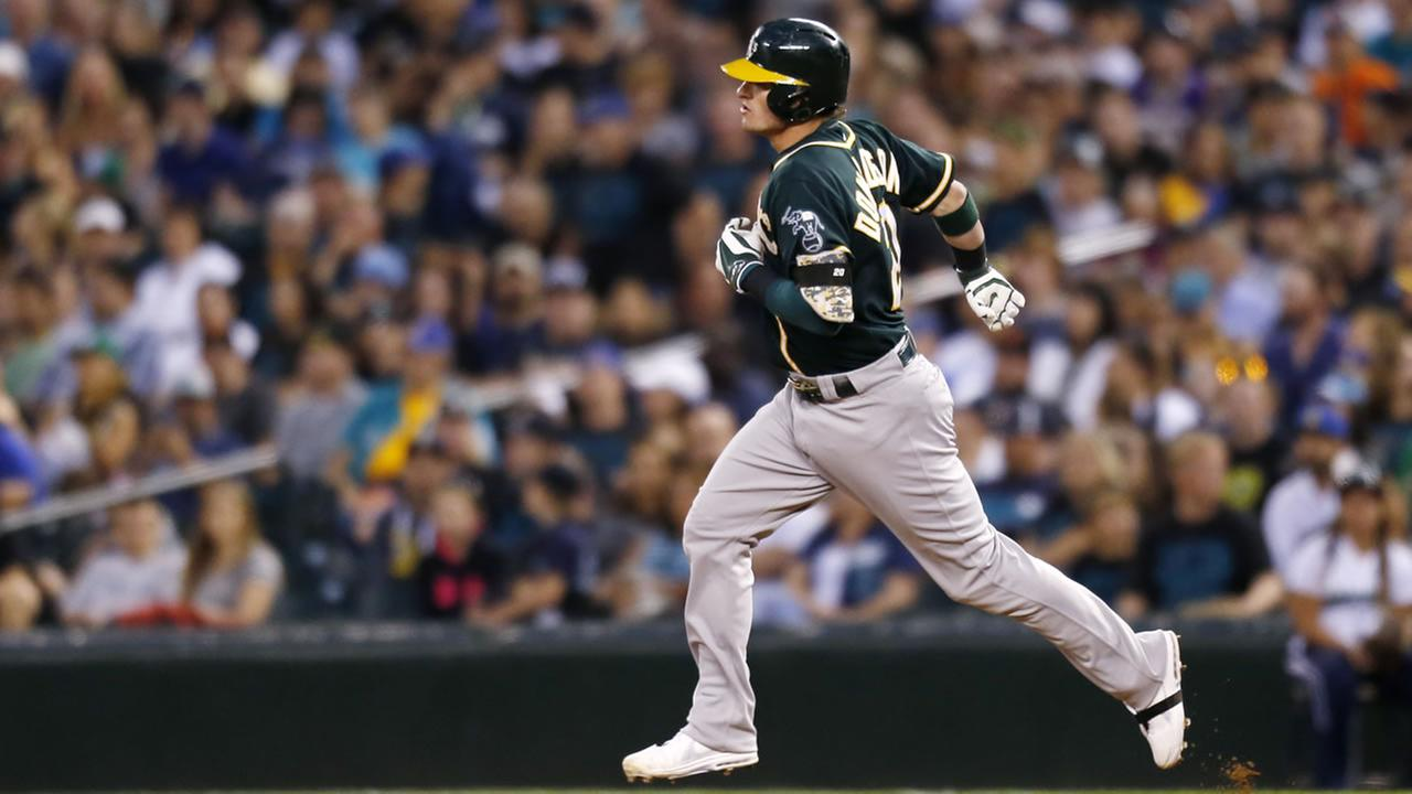 Oakland Athletics Josh Donaldson rounds the bases after hitting a home run against the Seattle Mariners during a baseball game on Saturday, Sept. 13, 2014 in Seattle. (AP Photo/John Froschauer)