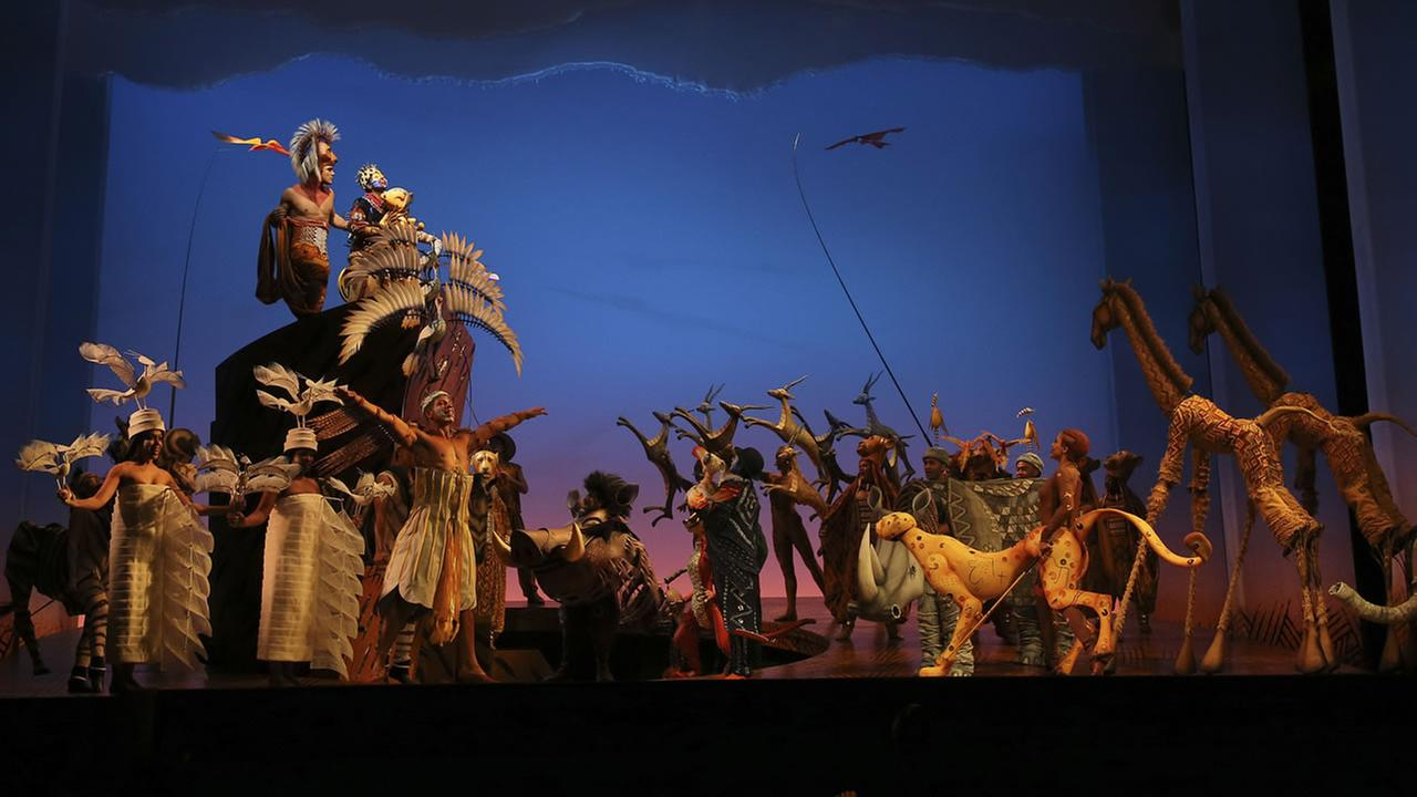 Actors perform in the Lion King