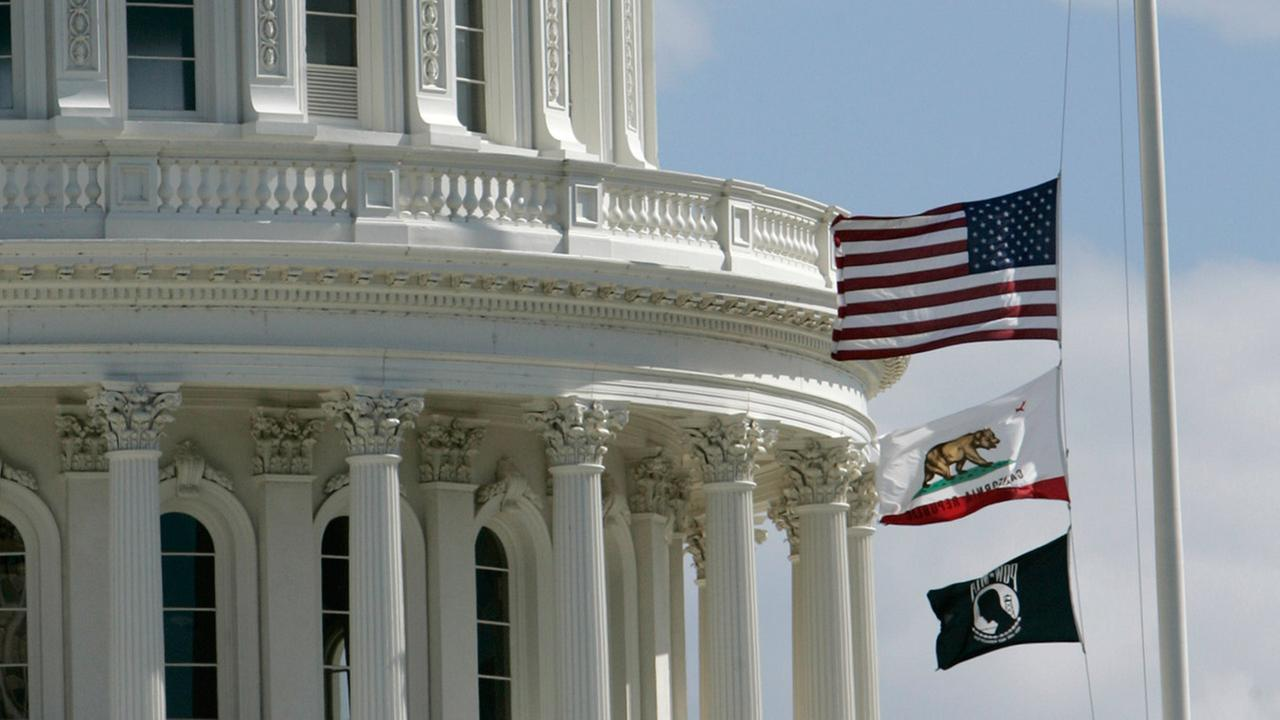 FILE -- Flags flown at half-staff at State Capitol in Sacramento, Calif., on Tuesday, April 17,2007.
