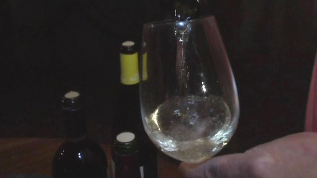 Pouring wine into a wineglass