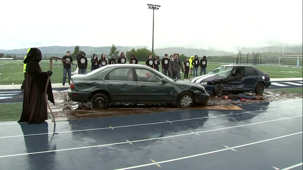 A simulated car crash appears at a San Jose high school as a safety exercise ahead of prom season on Tuesday, March 13, 2018.