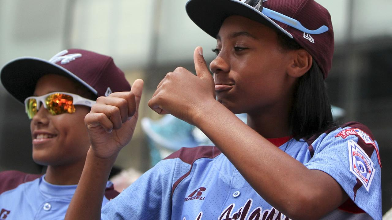 Taney Dragons Mone Davis gestures to fans during a parade in Philadelphia, Wednesday Aug. 27, 2014, to celebrate the teams accomplishments during the Little League World Series.
