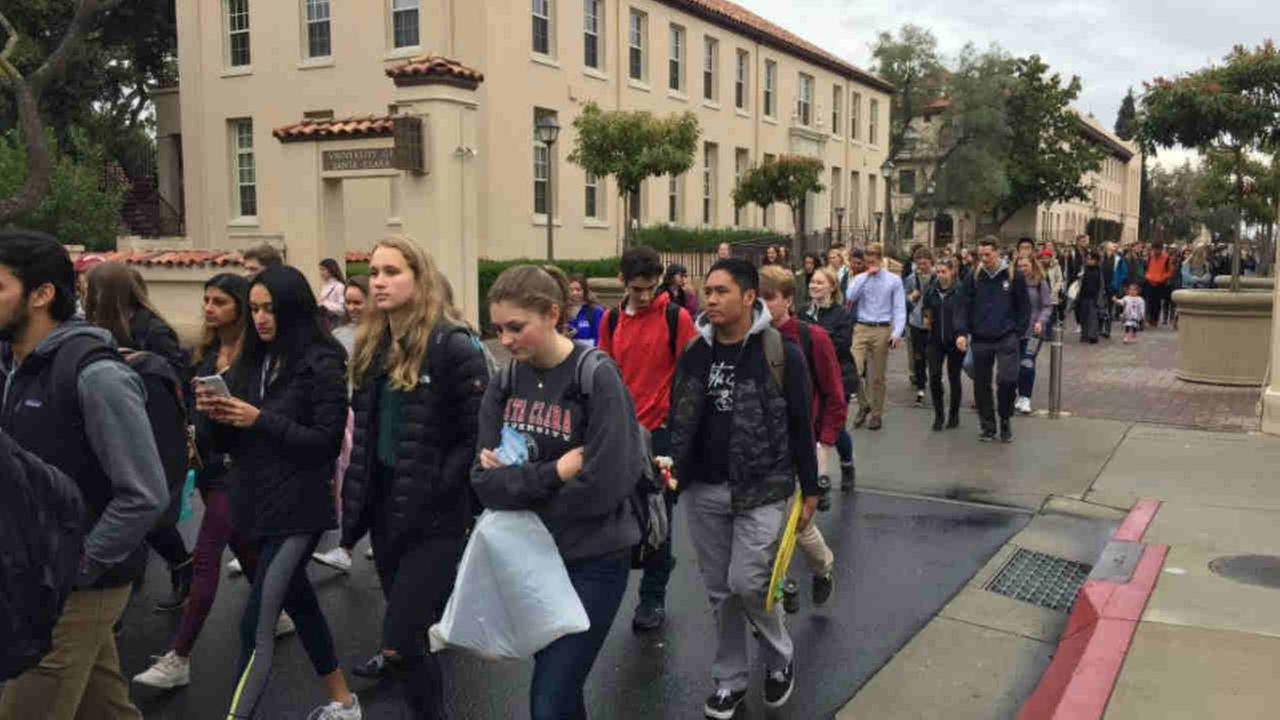 Santa Clara University students are seen walking out of class on Wednesday, March 14, 2018.