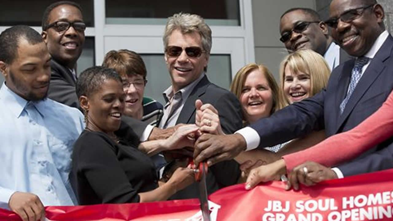 Rock star Jon Bon Jovi cuts ribbon at housing complex