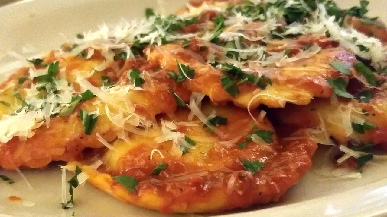 The chefs at The Sausage Factory in San Francisco serve up a plate of ravioli as the restaurant prepares to celebrate its 50th anniversary.