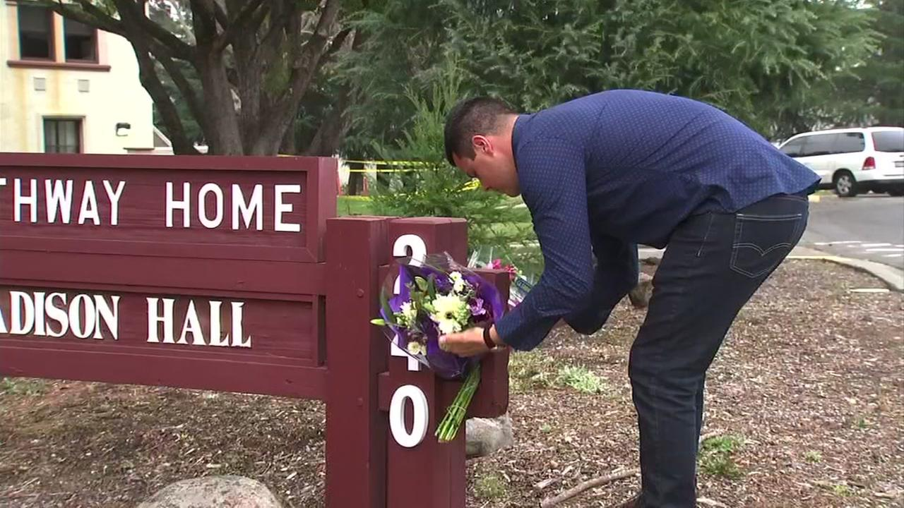 A man places flowers at the scene of the Yountville shooting at a veterans home in Yountville, Calif. on Thursday, March 15, 2018.