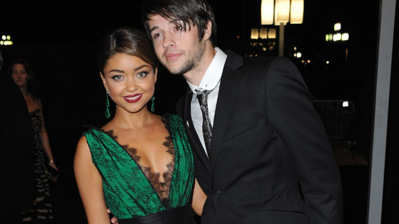 Sarah Hyland, left, and Matt Prokop pose for a photo at the Governors Ball at the 65th Primetime Emmy Awards, Sept. 22, 2013, in Los Angeles. (Photo by Richard Shotwell/Invision /AP)