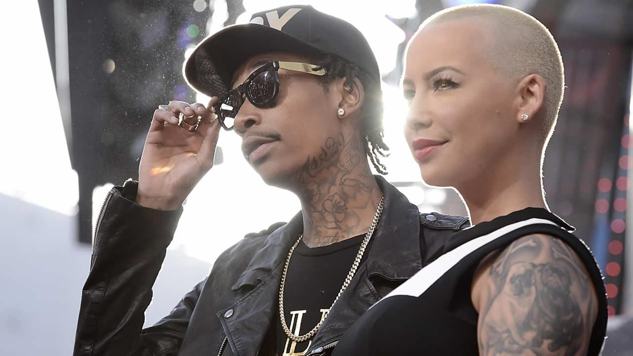 Rapper Wiz Khalifa, left, and Amber Rose arrive at the LA Premiere of the Fast and Furious 6 on May 21, 2013 in Universal City, Calif. (Photo by Dan Steinberg/Invision/AP)