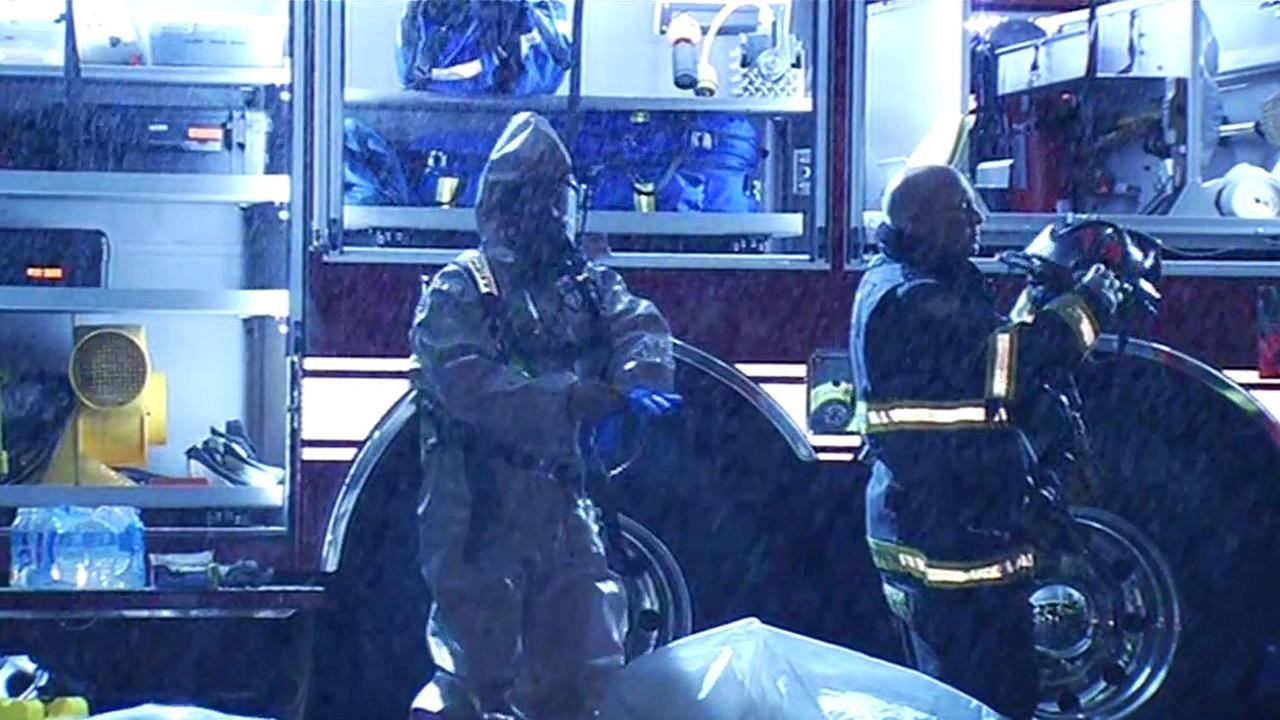 Hazmat crew investigates two dead bodies in Mountain View apartment.